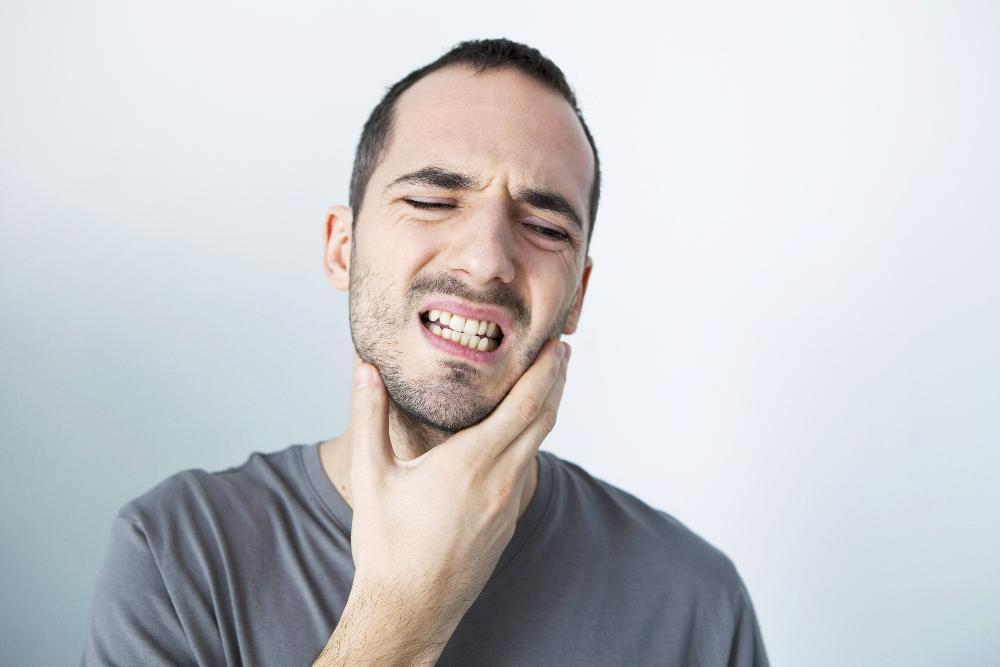 Patient in pain from bruxism in need of treatment in Prosper, TX