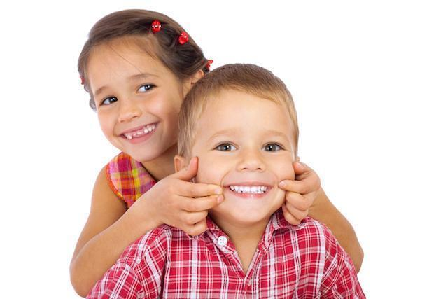 Young children smiling and hugging l Pediatric Dentistry Prosper TX