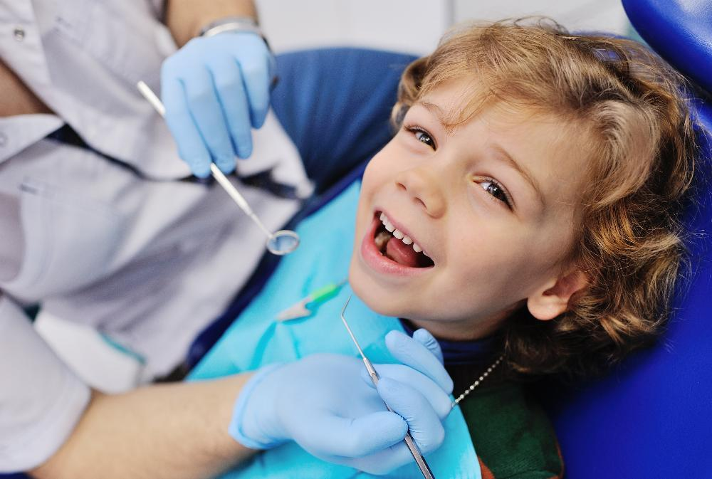 young boy receiving dental exam l dentist prosper tx