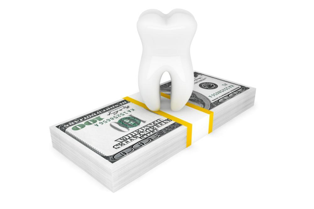 image of a cartoon tooth with a stack of money | Prosper TX