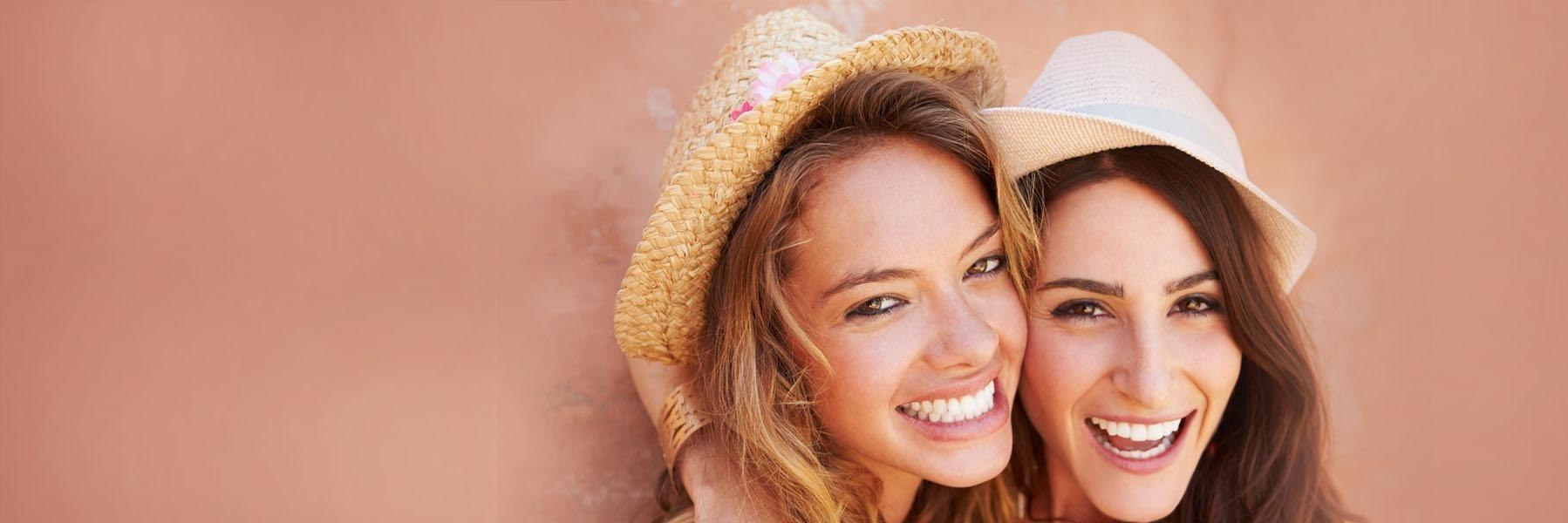 Women smiling with professional teeth whitening in Prosper TX