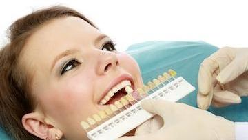 Woman at procedure for teeth whitening in Prosper TX